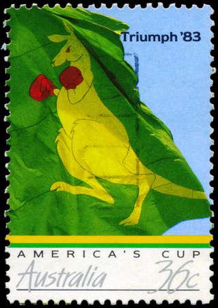 syndicate: AUSTRALIA - CIRCA 1986: A Stamp printed in AUSTRALIA shows the Australian Victory in the Americas Cup (1983), Boxing Kangaroo flag of winning syndicate, series, circa 1986 Editorial