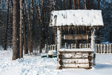 draw well: Landscape with the draw well on winter forest background