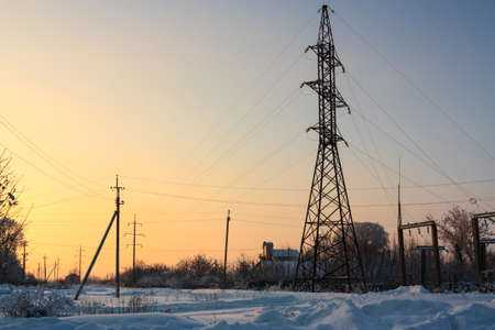 snowcovered: Winter evening landscape with power lines