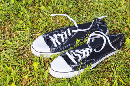 Sneakers on green grass background Stock Photo