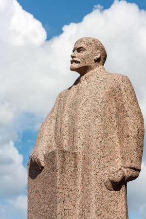 Vladimir Lenin granite monument on sky background
