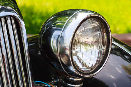 front facing: Head light of the vintage car Stock Photo