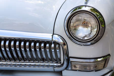 Front head light and gitter of the vintage car Stock fotó