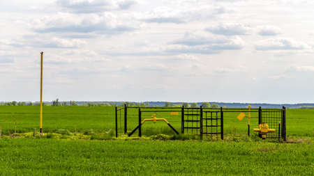 Landscape with gas pipeline in the field