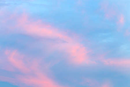 Abstract sunset sky background with pink and blue clouds