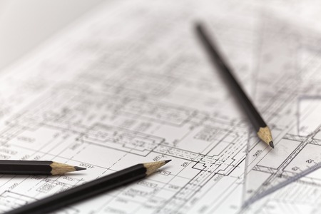 Pencils with a ruler on an architect plan