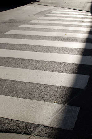 Asphalt road with white zebra crossing Standard-Bild
