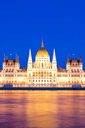 Hungarian Parliament in the blue hour   and Danube photo
