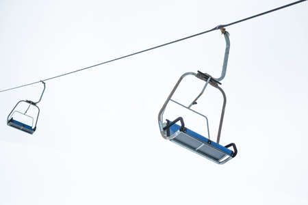 ski lift: Ski lift chairs on bright winter day