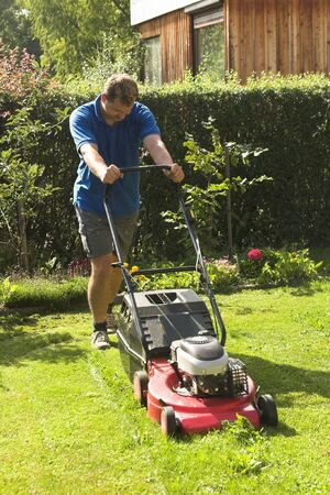 mowing lawn: cutting grass Stock Photo