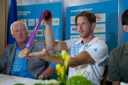 Brnik, SLOVENIA-august 5:luka �pik in iztok čop, comming bach from olimpic games in london on august 05, 2012 brnik, slovenija Editorial