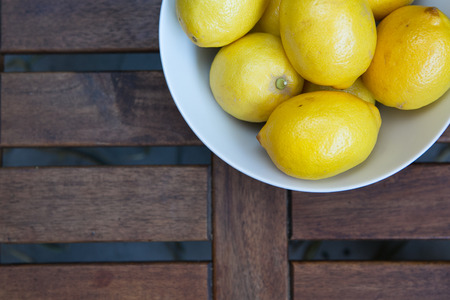 fresh yellow lemons on the wooden table