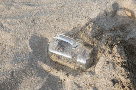 glass bottle in the sand on the seaside