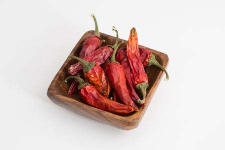 Dried Home Grown Chilli Peppers on the background
