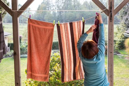 linen towels weighs outside and dry on a rope