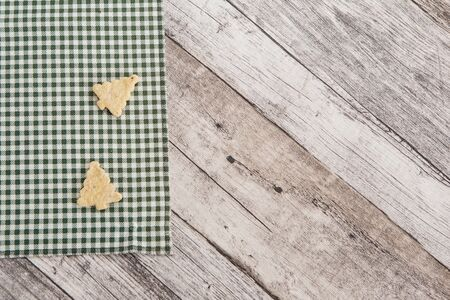 Festive time with home made cookies on the wodden table with wooden background