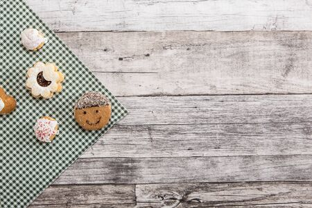 Festive time with home made cookies on the wodden table with wooden background Banco de Imagens