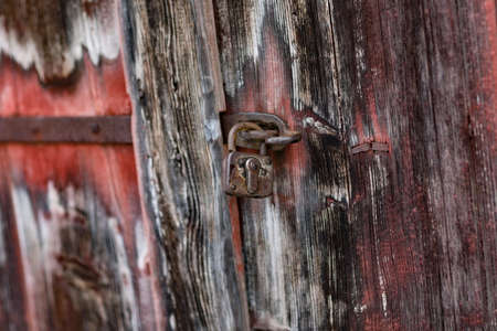 iron chain: Old lock at wooden door