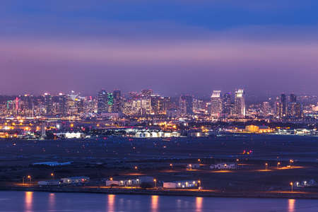 san diego: Military base with San Diego skyline in background after  dusk