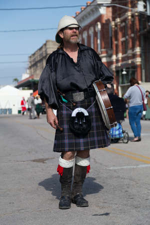 dickens: Galveston, TXUSA - 12 06 2014: Male drummer in traditional Scottish costume at Dickens on the Strand Festival in Galveston, TX Editorial
