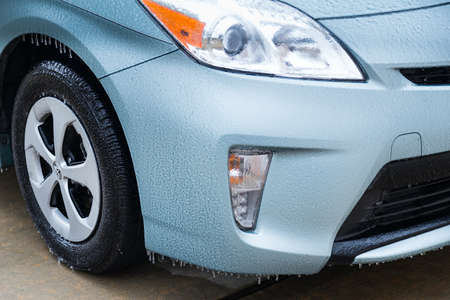 driving conditions: Pearland, TXUSA - 01 24 2014: Ice on car wheels during rare Ice Storm in Houston, TX area