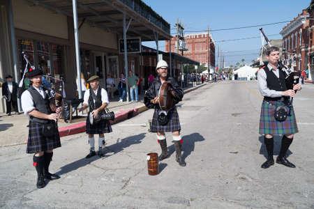 dickens: Galveston, TXUSA - 12 06 2014: Men dressed as Scottish musicians play harp at Dickens on the Strand Festival in Galveston, TX Editorial