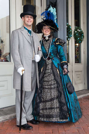 Galveston, TXUSA - 12 06 2014: Smiling couple dressed in Victorian style at Dickens on the Strand Festival in Galveston, TX