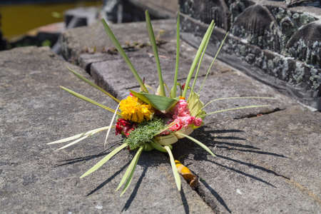offerings: Traditional balinese offerings to gods in Bali with flowers Stock Photo