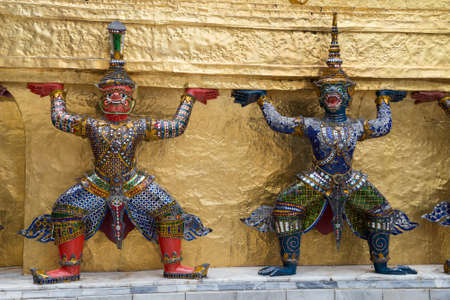 guardians: Warrior guardians in The Temple of the Emerald Buddha complex Stock Photo