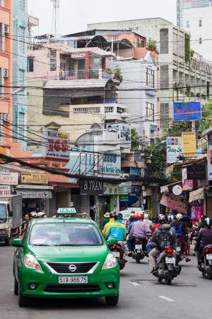 HO CHI MINH, VIETNAM - CIRCA AUGUST 2015: Street traffic in Ho Chi Minh City, Vietnam Editorial