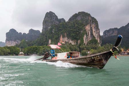 railay: RAILAY BEACH, THAILAND - CIRCA SEPTEMBER 2015: Boat sails in the Railay Beach, Thailand