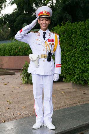 salutes: HANOI, VIETNAM - CIRCA AUGUST 2015: Vietnamese soldier salutes outside Ho Chi Minh mausoleum in Hanoi Editorial