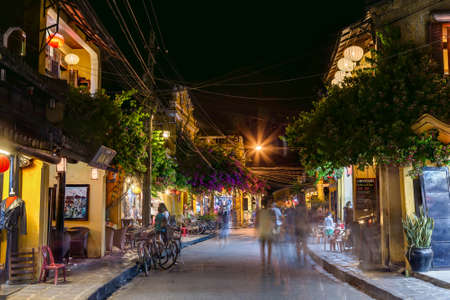 hoi an: HOI AN, VIETNAM - CIRCA AUGUST 2015: People walking on the streets of old town Hoi An, Vietnam by night