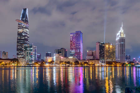 HO CHI MINH CITY, SAIGONVIETNAM - CIRCA AUGUST 2015: Lights of Saigon downtown skyline are reflected in the river