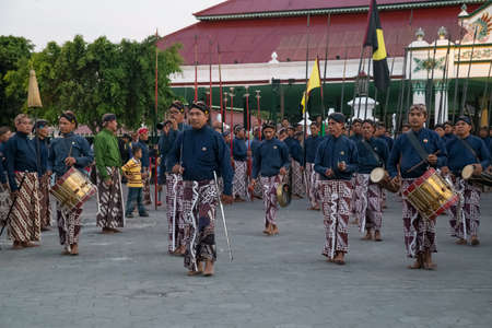 ceremonial: YOGYAKARTA, INDONESIA - CIRCA SEPTEMBER 2015: Ceremonial Sultan Guards in sarongs march in front of Sultan Palace (Keraton), Yogyakarta, Indonesia