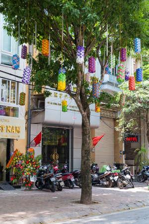 HANOI, VIETNAM - CIRCA AUGUST 2015: Lanterns hanging from the tree on the street of Hanoi, Vietnam