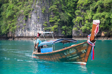 andaman sea: PHI PHI LEE ISLAND, THAILAND - CIRCA SEPTEMBER 2015: Boat sails in the Pileh Lagoon, Phi Phi Lee island, Andaman Sea, Thailand