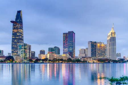vietnam: HO CHI MINH CITY, SAIGONVIETNAM - CIRCA AUGUST 2015: Lights of Saigon downtown skyline are reflected in the river