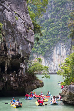 phang nga: PHANG NGA BAY, THAILAND - CIRCA SEPTEMBER 2015: Tourist kayaking tours in Phang Nga Bay of Andaman sea, Thailand