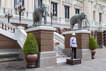 ceremonial: BANGKOK, THAILAND - CIRCA AUGUST 2015: Royal ceremonial guard stands outside Chakri Maha Prasat Hall, Bangkok, Thailand