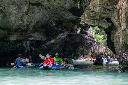 PHANG NGA BAY, THAILAND - CIRCA SEPTEMBER 2015: Tourist kayaking tours in Phang Nga Bay of Andaman sea, Thailand