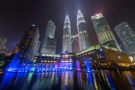 light show: Kuala Lumpur, Malaysia - circa September 2015: Panorama of Petronas Twin Towers and Lake Symphony by night