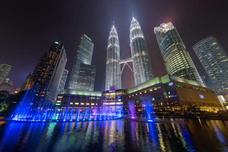 Kuala Lumpur, Malaysia - circa September 2015: Panorama of Petronas Twin Towers and Lake Symphony by night