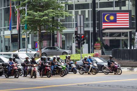 lumpur: Kuala Lumpur, Malaysia - circa September 2015: Motorbike riders in street traffic on the road in Kuala Lumpur, Malaysia