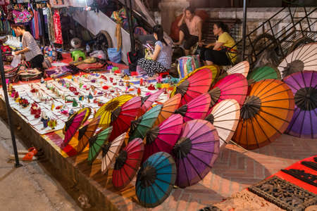 night market: Luang Prabang, Laos - circa August 2015: Souvenirs are sold at night market in Luang Prabang, Laos