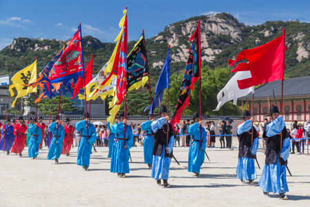 marching: Seoul, South Korea - circa September 2015: Palace guards marching in traditional Korean dresses in Gyeongbokgung Palace, Seoul, Korea