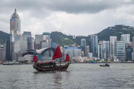 junk: Hong Kong, SAR China - circa July 2015: Chinese junk boat sails in Victoria Harbour, Hong Kong