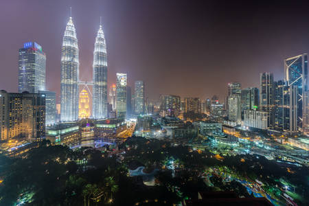 Kuala Lumpur, Malaysia - circa September 2015: Panorama of Petronas Twin Towers and Kuala Lumpur city park by night