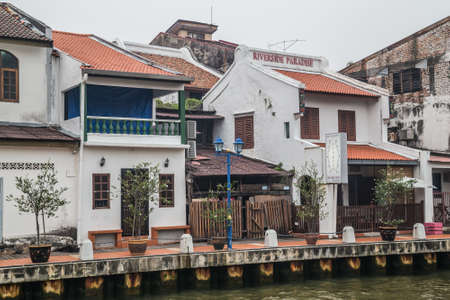 riverside: Malacca, Malaysia - circa September 2015: Riverside promenade with historical houses along Sungai Melaka, Malacca, Malaysia Editorial