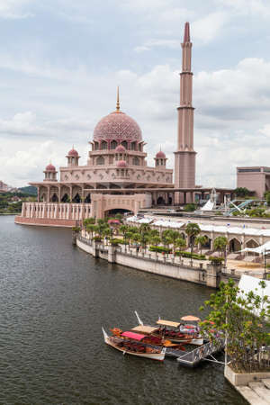 Putrajaya, Malaysia - circa September 2015: Putra Mosque on the bank of Putrajaya Lake in Putrajaya
